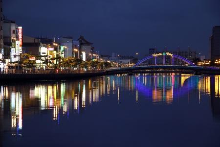 Bridge and Tainan canal at night, Taiwan photo