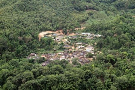 Old traditional village in the forest, Yunnan, China photo