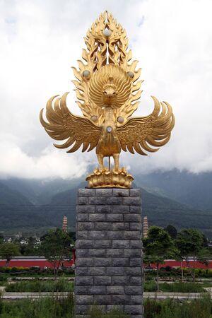 garuda: Golden buddhist bird Garuda in Dali, China Stock Photo