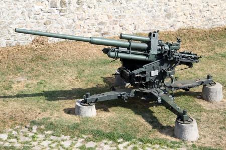 gunnery: Old big green anti-aircraft gun near the wall of Belgrade fortress, Serbia