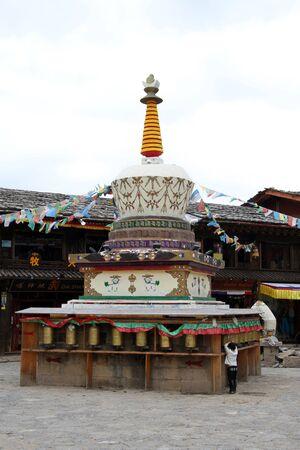 tibetian: Tibetian stupa on the square in Shangri-La, China Stock Photo
