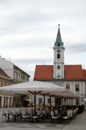 umbrela: Tables on the square and church in Varazhdin, Croatia