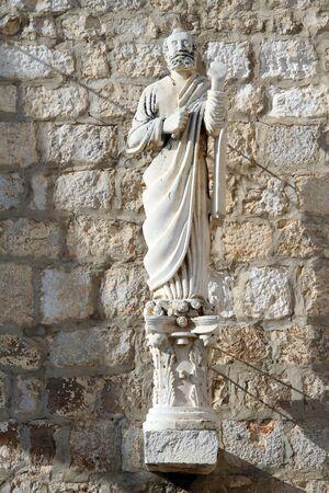 sain: Statue of sain near church in Supetar, Brach island, Croatia