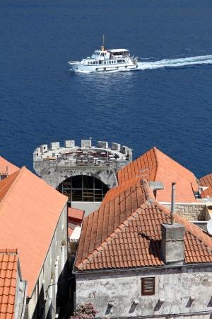Boat and roofs of Korchula, Croatia Stock Photo - 14988744