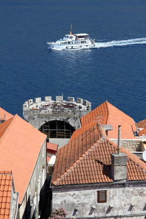 Boat and roofs of Korchula, Croatia Stock Photo - 14988744