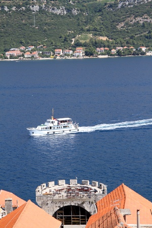 Tower and roof of Korchula and boat, Croatia  Stock Photo - 15004252