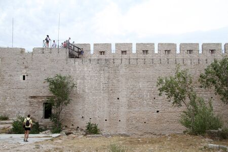 fortified: Tourists on the wall of fortress in Shibenik, Croatia