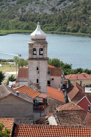High bell tower in Skradin, Croatia Stock Photo - 14988728