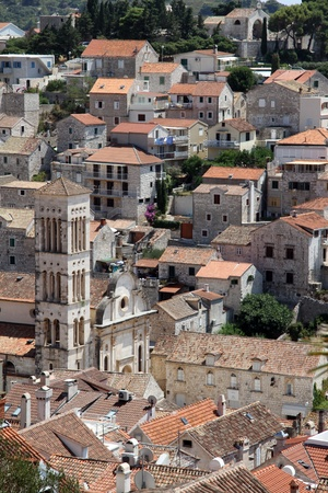 Bell tower and houses of Hvar, Croatia Stock Photo - 14989436