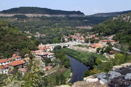 River and buildings in Veliko Tirnovo, Bulgaria photo