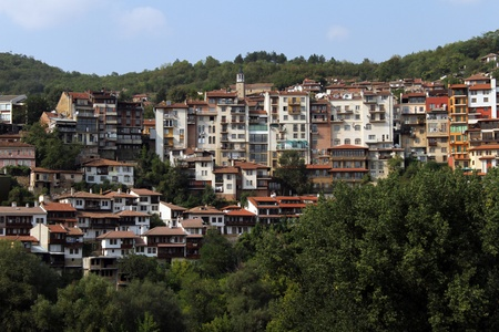 Forest park and houses in Veliko Tirnovo, Bulgaria photo