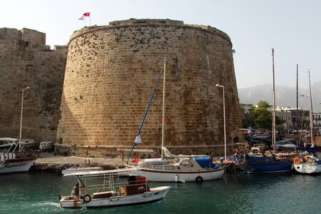 Boats near fortress in Girne, North Cyprus Stock Photo - 16628419