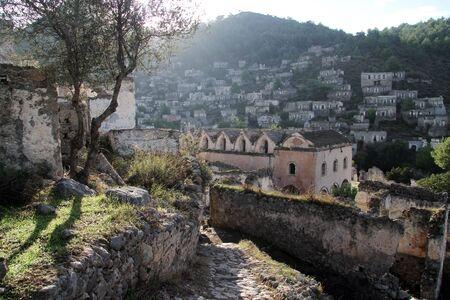 kayakoy: Church and ruins in greek village Kayakoy, Turkey Stock Photo