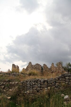 Clouds and ruins of old fortress near Milas, Turkey Stock Photo - 16648669