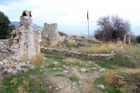 Ruins of fortress with flag near Milas, Turkey Stock Photo - 16651271