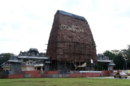 Restoration of cement gate of hindu temple in Ipoh, Malaysia photo