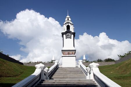 Cloud and white clocktower in Ipoh, Malaysia photo