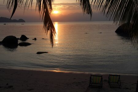Sunset and beach in Ko Phangan, Thailand photo