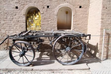 shush: Old iron cart in the inner yard of fortress in Shush, Iran