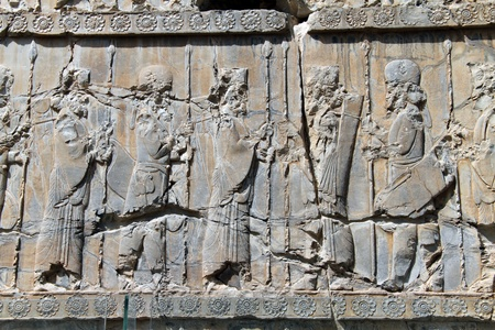 craked: Bas-relief with ceremony on the wall in Persepolis, Iran Editorial