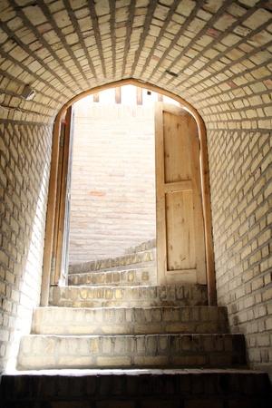 wooden door: Open door and staircase inside building