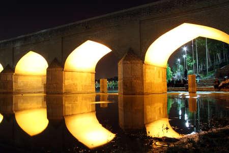 esfahan: Big arc bridge with light at night in Esfahan, Iran