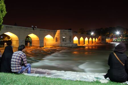 esfahan: People near river with bridge in Esfahan, Iran