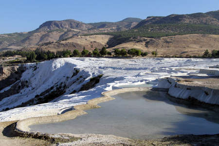 Water and travertine formations in Pamukkale, Turkey photo