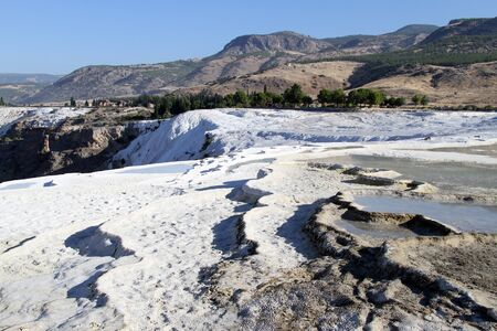 White travertine formations in Pamukkale, Turkey photo