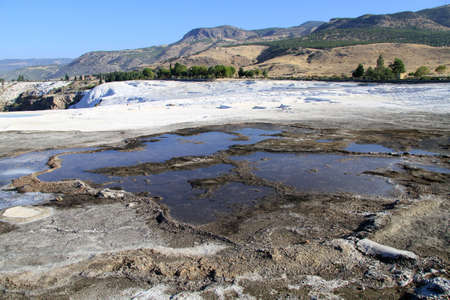 Wet travertine formations in Pamukkale, Turkey photo