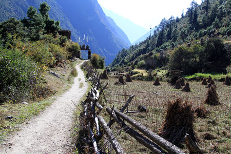 Footpath along the wooden fence in village in Nepal photo
