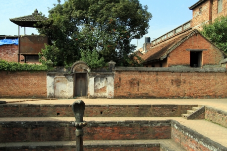 sacred source: Bronze cobra and fountain in kings palace in Bhaktapur, Nepal