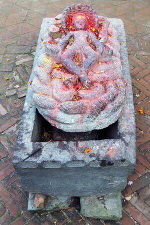 vishnu: Stone Vishnu god near temple Changu Narayan near Bhaktapur, Nepal Stock Photo