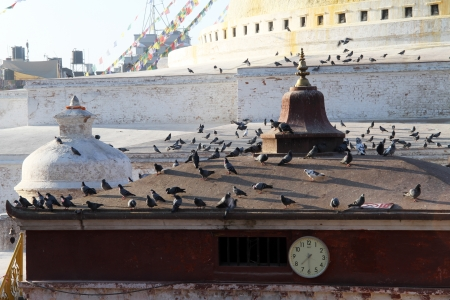 bodnath: Watch on the temple near stupa Bodnath in Kathmandu, Nepal
