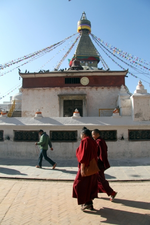 bodnath: Two monks walk near stupa Bodnath in Kathmandu, Nepal