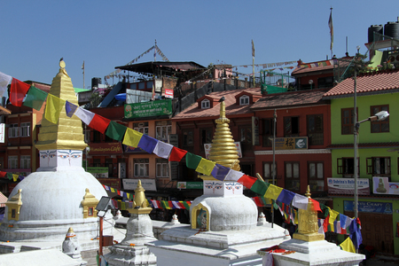 bodnath: Small white stupas and buildings near Bodnath in Kathmandu, Nepal Stock Photo