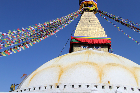 bodnath: People paint stupa Bodnath in Kathmandu, Nepal Stock Photo