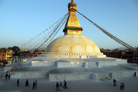 bodnath: People walk around stupa Bodnath in Kathmandu, Nepal