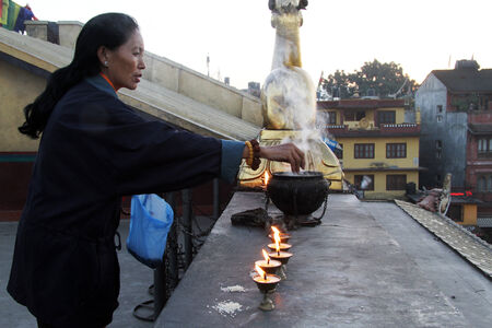 bodnath: KATHMANDU, NEPAL - CIRCA NOVEMBER 2013 Woman pray near stupa Bodnath