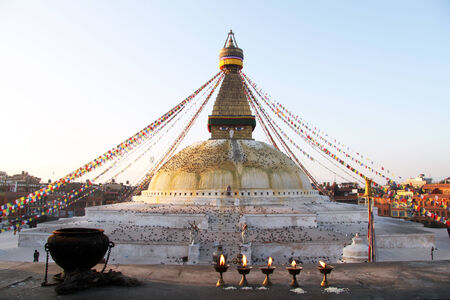 Lamps and bowl near stupa Bodnath in Kathmandu, Nepal photo