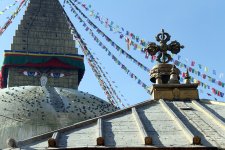 bodnath: Stupa Bodnath and roof of shrine in Kathmandu, Nepal Stock Photo