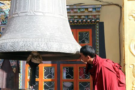 bodnath: Monk and big white bell near the stupa Bodnath in Kathmandu, Nepal