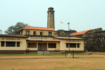 galle: Building near green field and wall of fortress in Galle, Sri Lanka