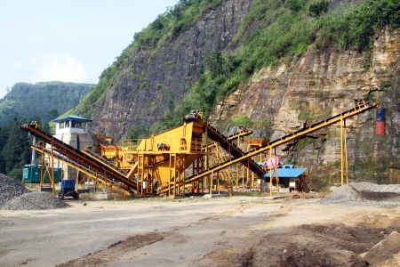 Yellow gravel conveyor near high mount photo