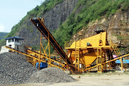 Yellow big gravel conveyor near mount photo