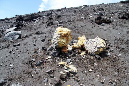 volcano slope: Sulphur rocks on the slope of volcano Krakatau in Indonesia
