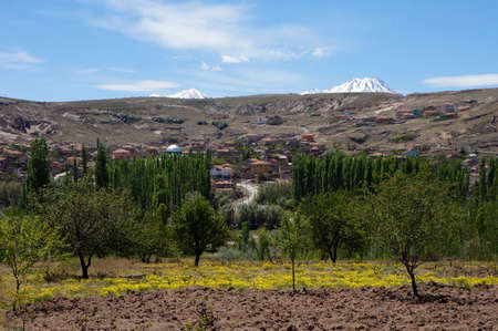 Farm fields and village in Ihlara valley in Cappadocia, Turkey                                photo