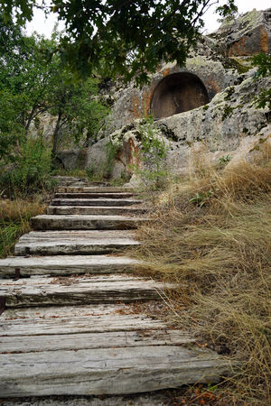 midas: Wooden steps to rock tomb in Midas, Turkey Stock Photo