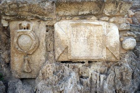 caesarea: Simbol of roman legion on the wall of aqueduct near Caesarea in Israel