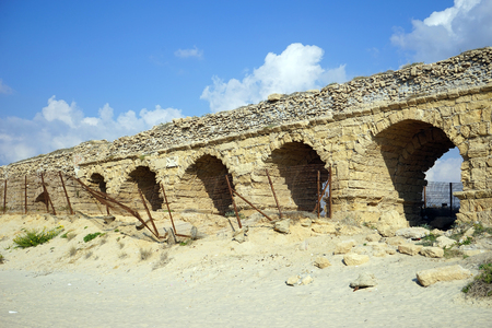 caesarea: Long aqueduct near ruins of ancient Caesarea, Israel